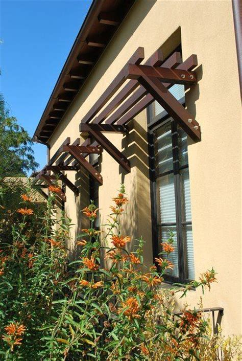 rustic exterior awnings casement windows stucco wall overhang arbor trellis layout