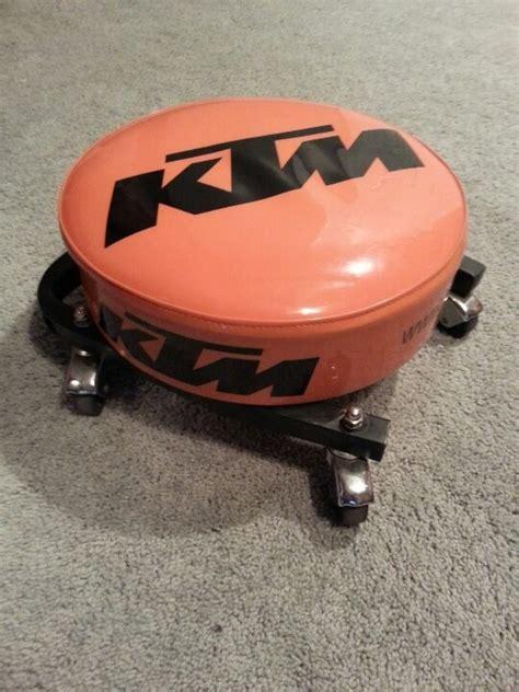 took ktm shop stool top lowered onto a mechanics wheel