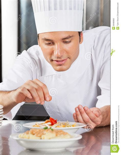 Chef Sprinkling Spices On Dish Stock Photo  Image 36486902