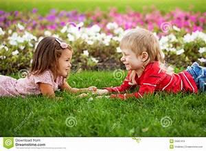 Couple Of Kids Looking Eye To Eye. Stock Photo - Image ...