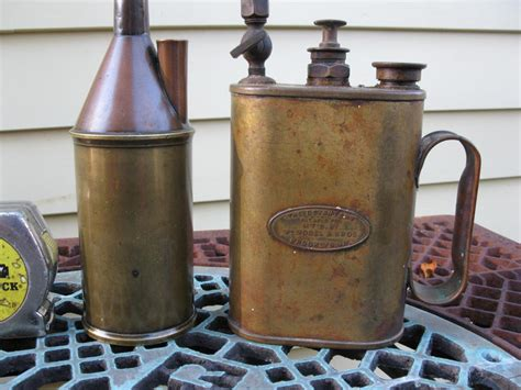 4 Brass Oil Cans And A Tray