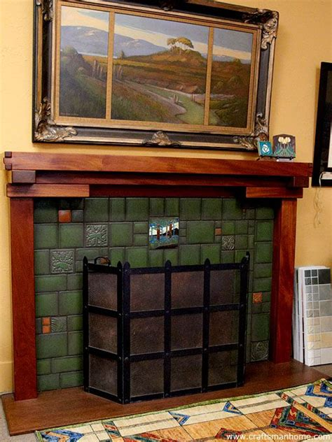 arts and crafts tiles surround a fireplace with a greene