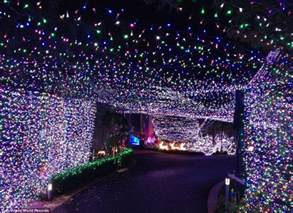 family claim guinness world record for christmas light display with 502 165 flickering bulbs
