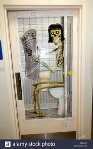 poster of a woman skeleton sitting on toilet reading With bathroom reading online