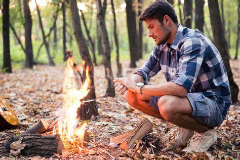 sitting near bonfire in the forest stok fotoğraf 169 dean drobot deandrobot 6277360