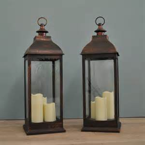 two firenze battery operated candle lanterns in copper by garden selections notonthehighstreet com