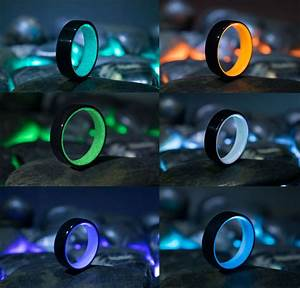 These glowing rings are made of carbon fiber and volcanic rock for Glow in the dark wedding rings