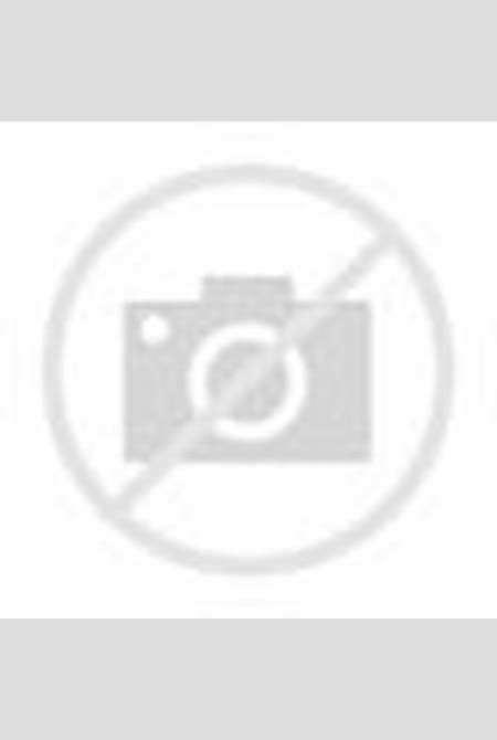 Emily Bloom relaxes naked outdoors in a field