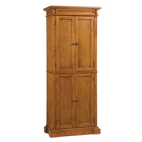 white pantry cabinet lowes shop home styles distressed oak pantry at lowes com