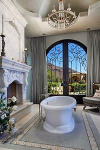 Luxury Master Bathroom. this is so cool with the fireplace ...