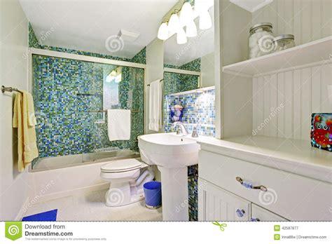 refreshing white bathroom  aqua tile wall trim stock