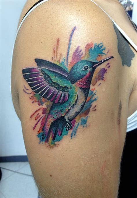 grey ink flying colibri tattoo  forearm  delan canclini
