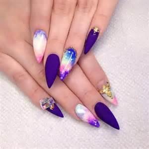 Black hearts negative space stiletto nails