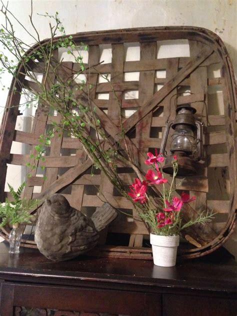 Basket decoration basket wall art basket wall decor home deco baskets on wall home decor house styles decor styles living room inspo. using a tobacco basket in the decor for spring and summer   Spring and Summer Farmhouse ...