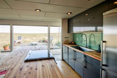 stunning shipping container home   glass wall