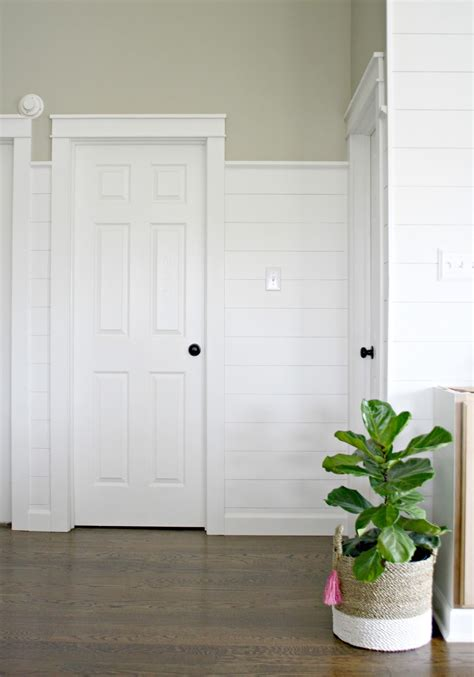 thrifty decor door trim finished shiplap walls and farmhouse door trim in the loft