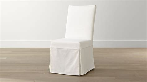 white chair slipcover slip white slipcovered dining chair crate and barrel