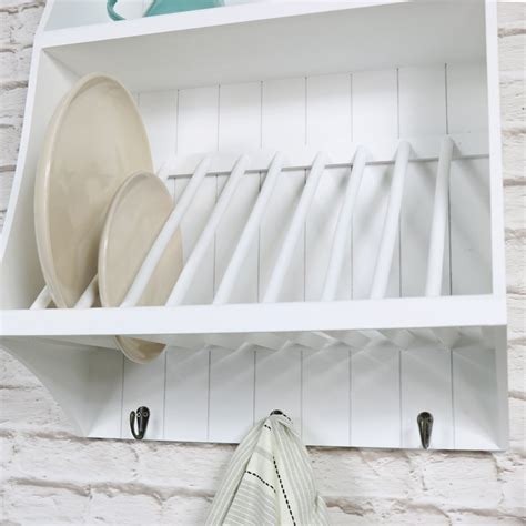 white wall mounted wooden plate rack  hooks