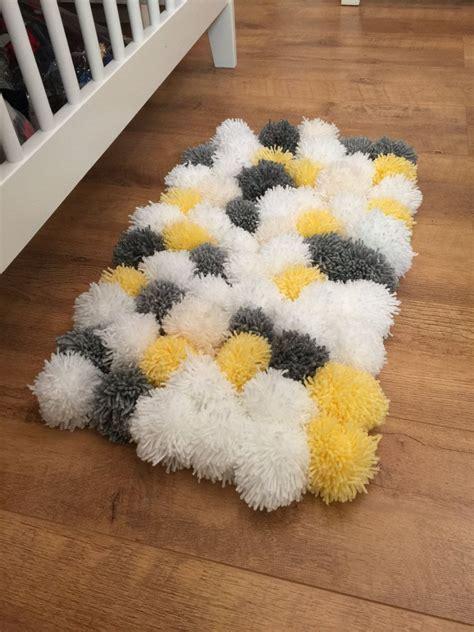 gorgeous fluffy pom pom rug perfect   nursery