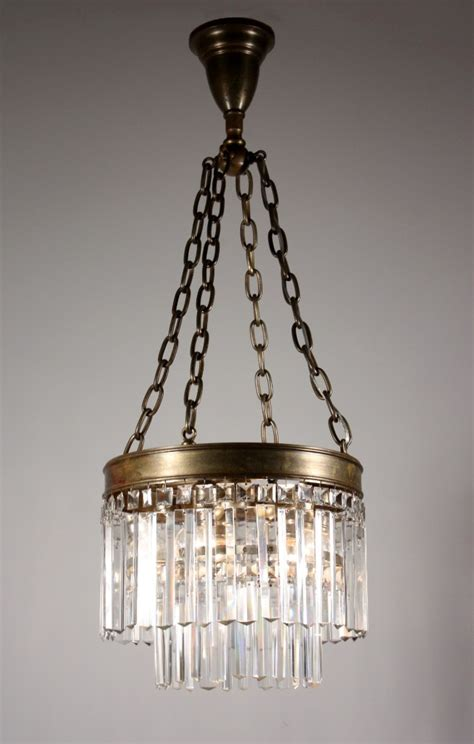 antique two tier chandelier with cut prisms