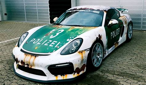 rusty car driving rust wrap police car porsche cayman gt4 by wrapstyle