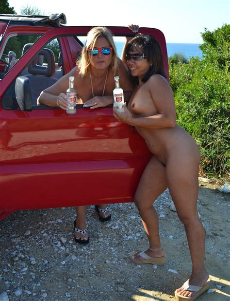 Blonde Milf In Multi Colored Dress And A Hot Cougar In Blue Bikini Strip Off Their Clothes Then