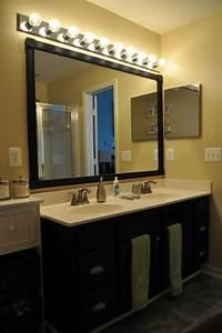 une armoire de salle de bain avec miroir pour le style de With grand miroir pour salle de bain