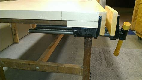 installing  front mounted workbench vise woodbin