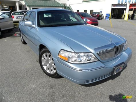 2011 light blue metallic lincoln town car signature