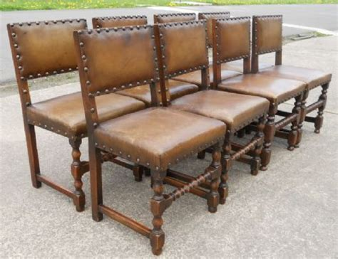 eight leather oak studded back cromwellian style dining