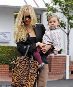Kimberly Stewart and her baby daughter Delilah grab a bite ...
