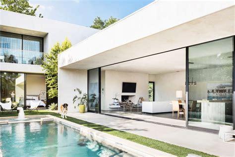 sleek modern home is an indoor outdoor in dallas