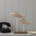 carved wooden fish by the nautical home ...