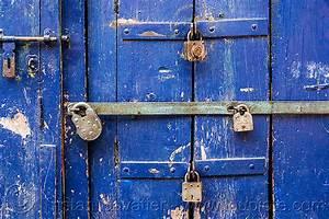 barred door with padlocks, india