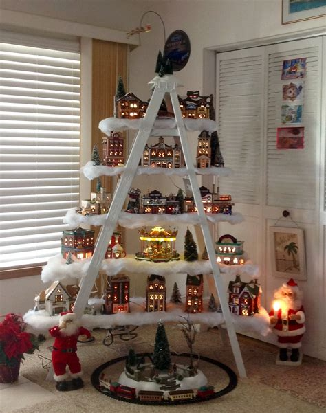 ladder christmas tree displaying village christmas