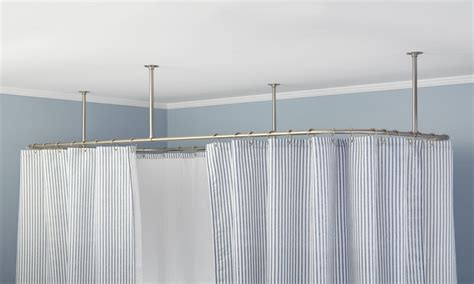 large clawfoot tub ceiling suspended shower curtain rod