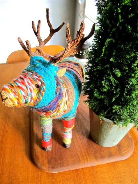 craft  colorful yarn wrapped animal statue homejelly