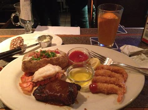Steak, lobster, shrimp, baked potato .and a Shock Top ...