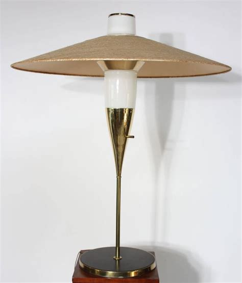 rare brass and glass table l by raymond loewy for
