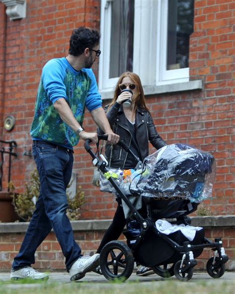 car seat stroller isla fisher and sacha baron cohen take their 4 month