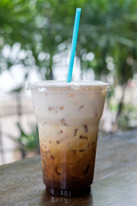 Download this free photo about iced coffee cup, and discover more than 8 million professional stock photos on freepik. Iced coffee latte in takeaway cup on nature bokeh | Premium Photo