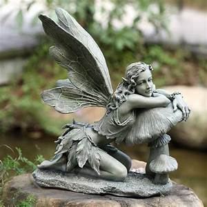 40 stunningly beautiful statues of fairies and angels for for Fairy statues for garden