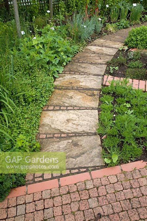 curved garden path gap gardens a curved path made from square paving stones garden organic at ryton image no