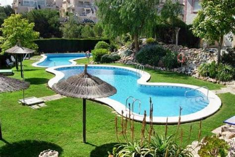 backyard swimming pools tropical umbrella with unique shaped swimming pool designs for small yards with decorative
