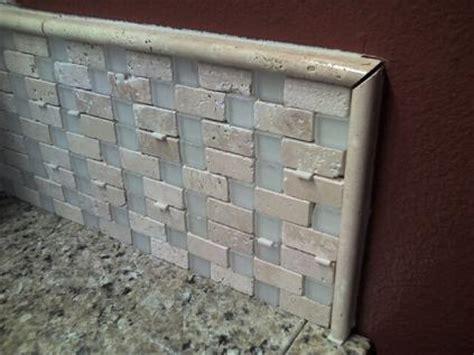 ceramictec granite tile counter with a travertine