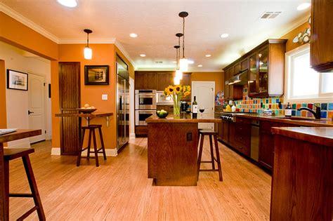 eye catching orange kitchen design with colorful ceramic tiles backsplash and glossy wood