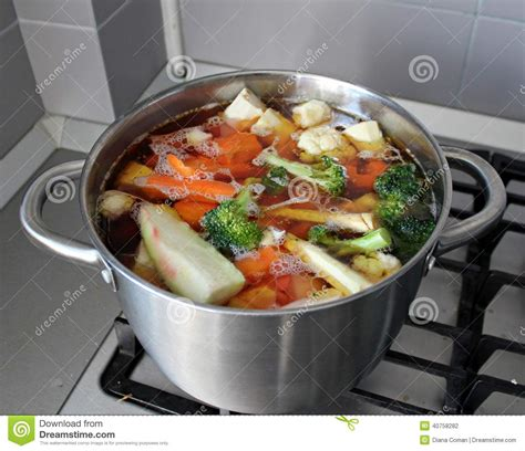cooking chicken in broth cooking soup stock photo image 40758282