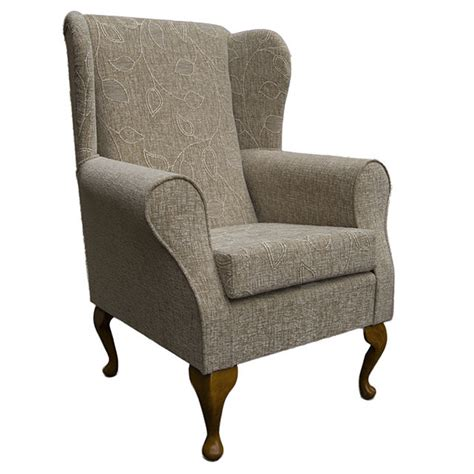 floral oatmeal fabric wing back orthopaedic fireside chair