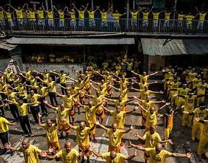 Inmates participate in a group dance contest inside the ...