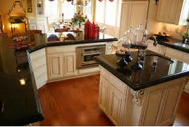 The Absolute Black Is Polished The Edge Detail Is A 2 1 4 Ogee Step Dark Deluxe Stainless Steel Appliances Black Kitchen Cabinets A Dark Countertop Color Ideas HGTV Black Kitchen Countertops Home Design Ideas